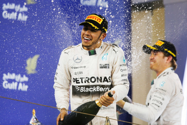 Bahrain International Circuit, Sakhir, Bahrain. Sunday 19 April 2015. Lewis Hamilton, Mercedes AMG, 1st Position, and n3rd spray the Rose Water on the podium. World Copyright: Charles Coates/LAT Photographic. ref: Digital Image _J5R1318