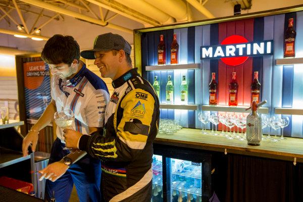 Autosport International Exhibition.  National Exhibition Centre, Birmingham, UK. Sunday 17 January 2016.  Petter Solberg learns how to mix Martini cocktails on the Williams motorhome. World Copyright: Zak Mauger/LAT Photographic. ref: Digital Image _L0U9416