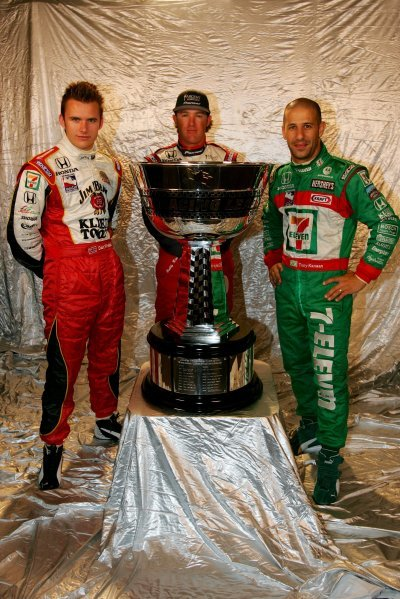 L-R: The 2004 IRL title contenders; Dan Wheldon (GBR), Andretti Green Racing; Buddy Rice (USA) Rahal Letterman Racing; Tony Kanaan (BRA), Andretti Green Racing. Kanaan won the championship.