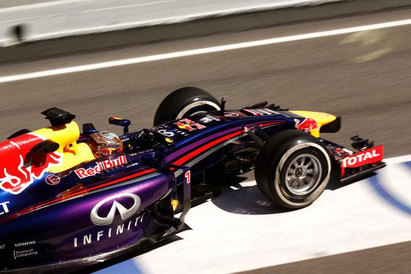 Circuit de Catalunya, Barcelona, Spain. Wednesday 14 May 2014. Sebastian Vettel, Red Bull Racing RB10 Renault, leaves the pits. World Copyright: Sam Bloxham/LAT Photographic. ref: Digital Image _SBL0454