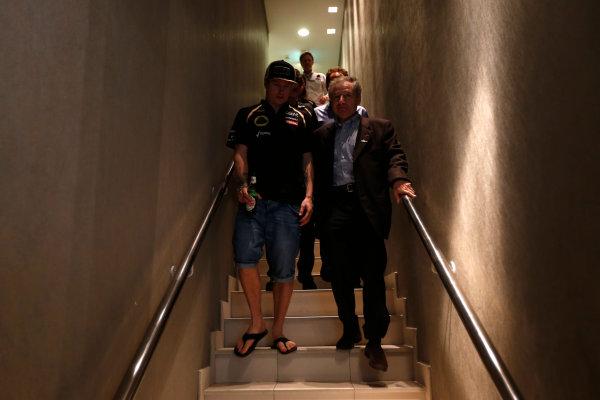 Yas Marina Circuit, Abu Dhabi, United Arab Emirates Sunday 4th November 2012. Kimi Raikkonen, Lotus GP, with Jean Todt, President, FIA.  World Copyright: Andrew Ferraro/  ref: Digital Image _79P4036