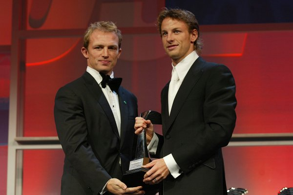 2003 AUTOSPORT AWARDS, The Grosvenor, London. 7th December 2003.Jenson Button is handed the trophy for British Competition driver of the year from England Rugby Wolrd Cup hero, Matt Dawson.Photo: Peter Spinney/LAT PhotographicRef: Digital Image only