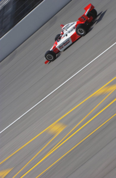 IRL IndyCar Series Delphi Indy 300, Chicagoland Speedway, Joilet,Illinois,USA 7 September,2003 Helio Castroneves speeds past the pit entrance.World Copyright-F Peirce Williams 2003 LAT Photographicref: Digital Image Only