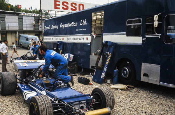 Mechanics prepare Jackie Stewart's March 701 Ford in the paddock.