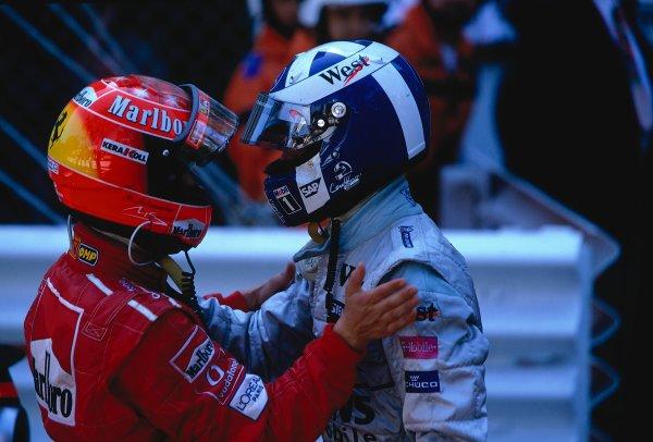2002 Monaco Grand Prix. Monte Carlo, Monaco. 23-26 May 2002. Michael Schumacher (Ferrari) 2nd position congratulates David Coulthard (McLaren Mercedes) on his 1st position and second victory in the principality. Ref-02 MON 31. World Copyright - LAT Photographic