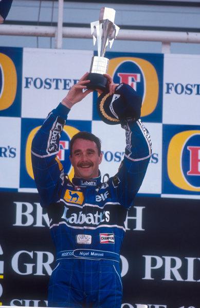 1992 British Grand Prix.Silverstone, England.10-12 July 1992.Nigel Mansell (Williams FW14B Renault) celebrates 1st position on the podium.Ref-92 GB 11.World Copyright - LAT Photographic