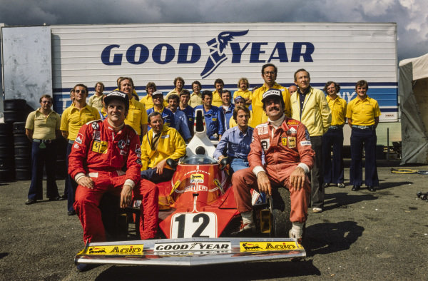 Ferrari team photo with drivers Niki Lauda and Clay Regazzoni, engineer Mauro Forghieri, and team boss Luca di Montezemolo with the Ferrari 312T.