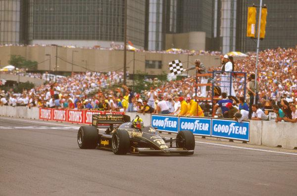 Detroit, Michigan, U.S A.20-22 June 1986.Ayrton Senna (Lotus 98T Renault) crosses the line for victory.Ref-86 USA 09.World Copyright - LAT Photographic