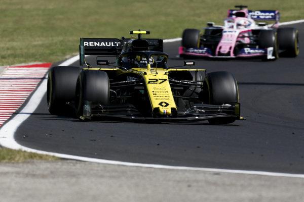 Nico Hulkenberg, Renault R.S. 19, leads Sergio Perez, Racing Point RP19