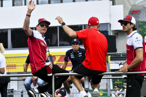 Kimi Raikkonen, Alfa Romeo Racing, Sebastian Vettel, Ferrari and Antonio Giovinazzi, Alfa Romeo Racing on the drivers parade truck