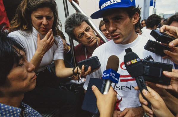 Ayrton Senna talks to the press.