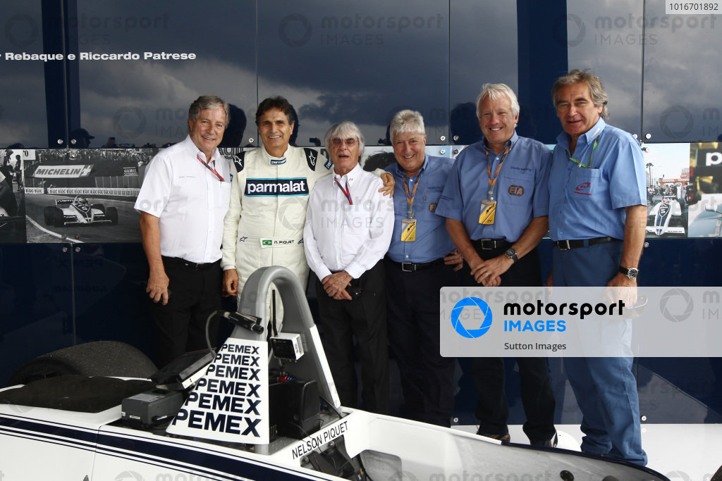 Alan Woollard (GBR), Nelson Piquet (BRA), Bernie Ecclestone (GBR) CEO Formula One Group (FOM), Herbie Blash (GBR) FIA Delegate, Charlie Whiting (GBR) FIA Delegate  with the Brabham BT49C. 