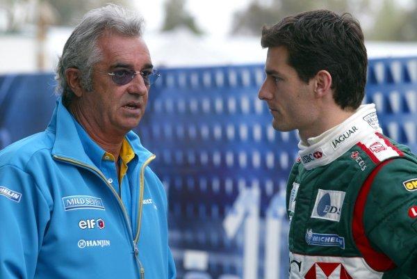 (L to R): Flavio Briatore (ITA) Renault Team Principal talks with Mark Webber (AUS) Jaguar. Formula One World Championship, Rd1, Australian Grand Prix, Albert Park, Melbourne, Australia, 7 March 2003. DIGITAL IMAGE