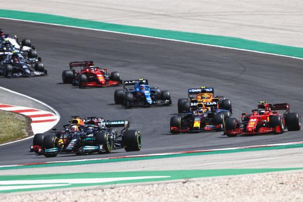 Sir Lewis Hamilton, Mercedes W12, leads Max Verstappen, Red Bull Racing RB16B, Carlos Sainz, Ferrari SF21, Sergio Perez, Red Bull Racing RB16B, Lando Norris, McLaren MCL35M, Esteban Ocon, Alpine A521, and Charles Leclerc, Ferrari SF21
