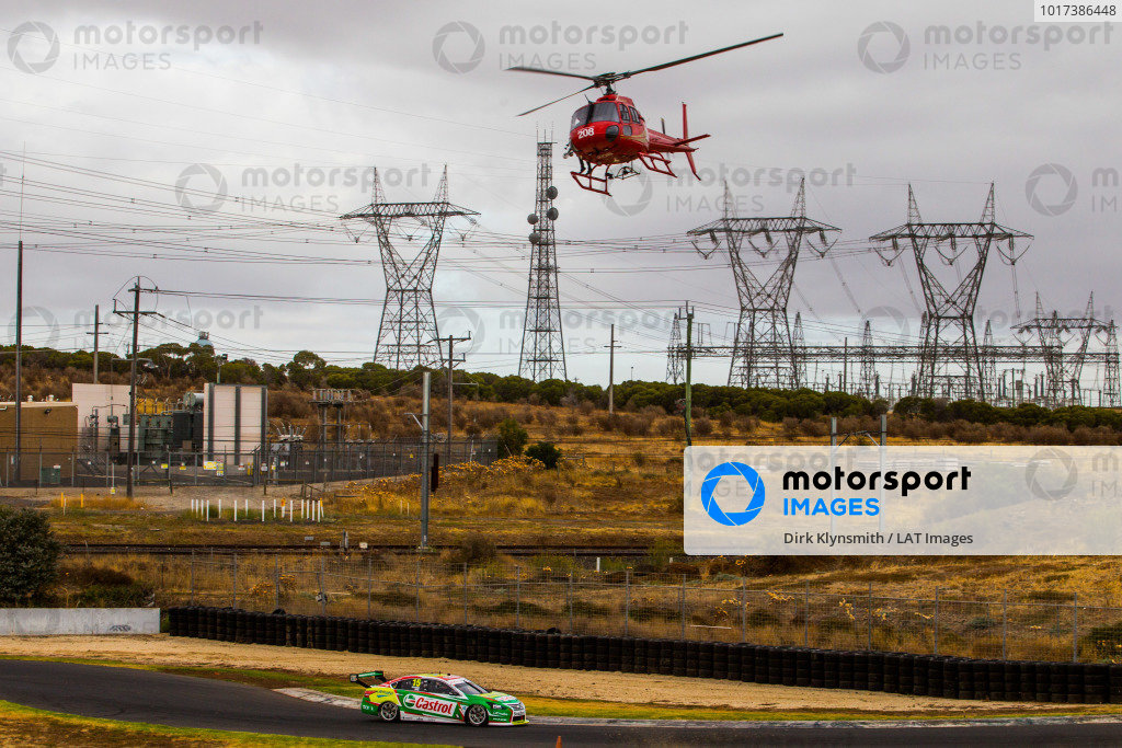 Daniel Ricciardo tests Kelly Racing Nissan Supercar at Calder. A helicopter flies over pylons