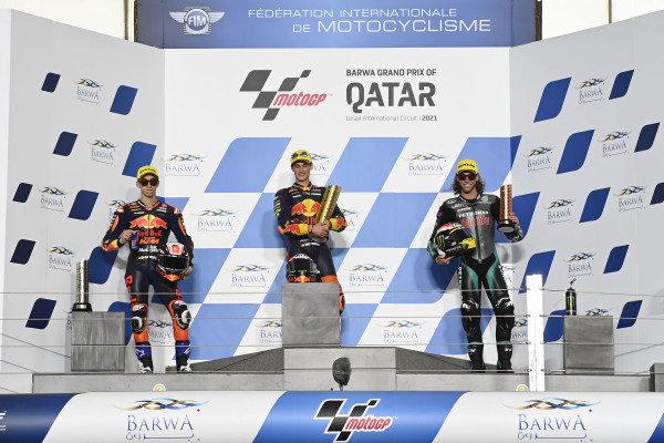 Jaume Masia, Red Bull KTM Ajo, Pedro Acosta, Red Bull KTM Ajo, Darryn Binder, Petronas Sprinta Racing podium.