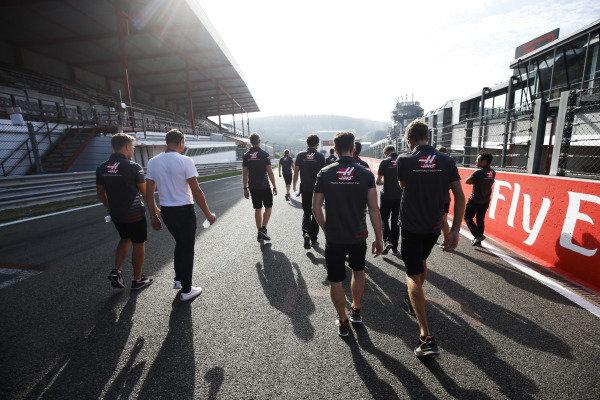 Kevin Magnussen, Haas F1 Team, and Romain Grosjean, Haas F1 Team, walk the circuit.