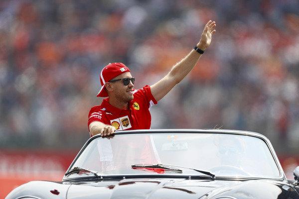 Sebastian Vettel, Ferrari, waves to fans on the drivers' parade.