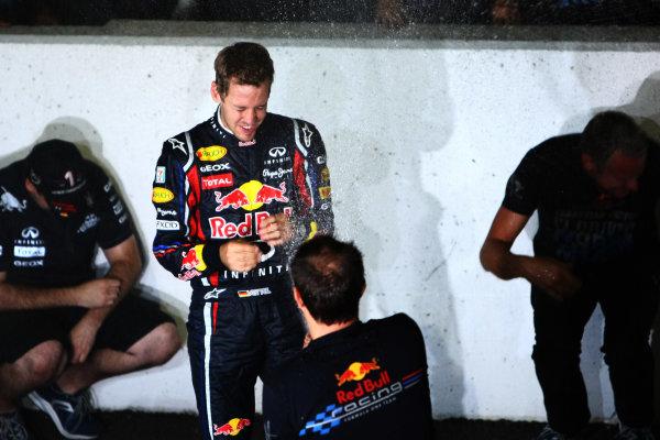 Suzuka Circuit, Suzuka, Japan.9th October 2011.Sebastian Vettel, Red Bull Racing RB7 Renault, 3rd position, celebrates his second world championship with his team. Portrait. Atmosphere. World Copyright: Andy Hone/LAT Photographicref: Digital Image CSP25970