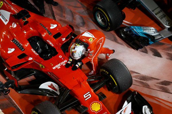 Bahrain International Circuit, Sakhir, Bahrain.  Sunday 16 April 2017. Sebastian Vettel, Ferrari SF70H, celebrates with his car in Parc Ferme after winning the race. World Copyright: Steven Tee/LAT Images ref: Digital Image _R3I0385