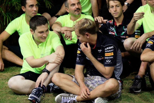Marina Bay Circuit, Singapore. Sunday 22nd September 2013.  Sebastian Vettel, Red Bull Racing celebration team photo.  World Copyright: Charles Coates/LAT Photographic. ref: Digital Image _X5J0172