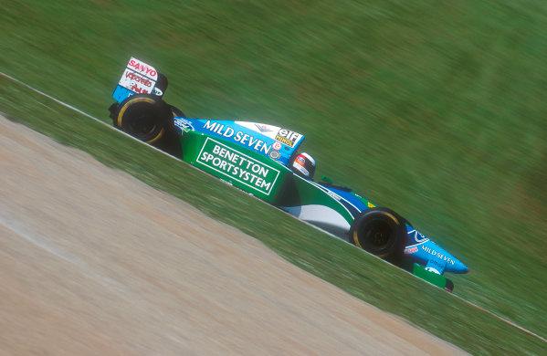 Imola, Italy.29/4-1/5 1994.Michael Schumacher (Benetton B194 Ford) celebrates 1st position. Ref-94 SM 48.World Copyright - LAT Photographic