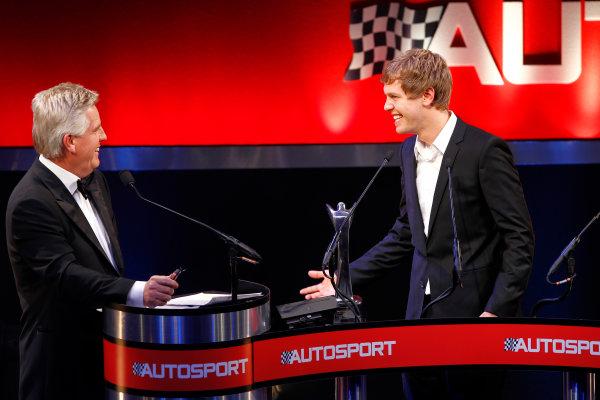 Grosvenor House Hotel, Park Lane, London 5th December 2010 Sebastian Vettel shares a joke with Steve Ryder.World Copyright: Andrew Ferraro/LAT Photographic ref: Digtal Image _Q0C9072
