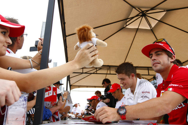 Hungaroring, Budapest, Hungary26th July 2012Fernando Alonso, Ferrari is given a toy lion as he signs his autograph for fans.World Copyright:Charles Coates/LAT Photographicref: Digital Image _26Y9246