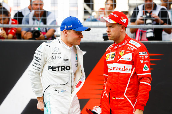 Circuit of the Americas, Austin, Texas, United States of America. Saturday 21 October 2017. Valtteri Bottas, Mercedes AMG, and Sebastian Vettel, Ferrari, talk on the grid after Qualifying. World Copyright: Steven Tee/LAT Images  ref: Digital Image _O3I3997