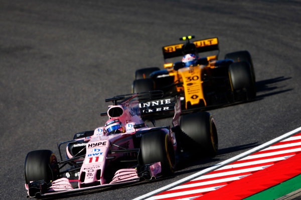 Suzuka Circuit, Japan. Sunday 08 October 2017. Sergio Perez, Force India VJM10 Mercedes, leads Jolyon Palmer, Renault R.S.17. World Copyright: Andy Hone/LAT Images  ref: Digital Image _ONZ4539