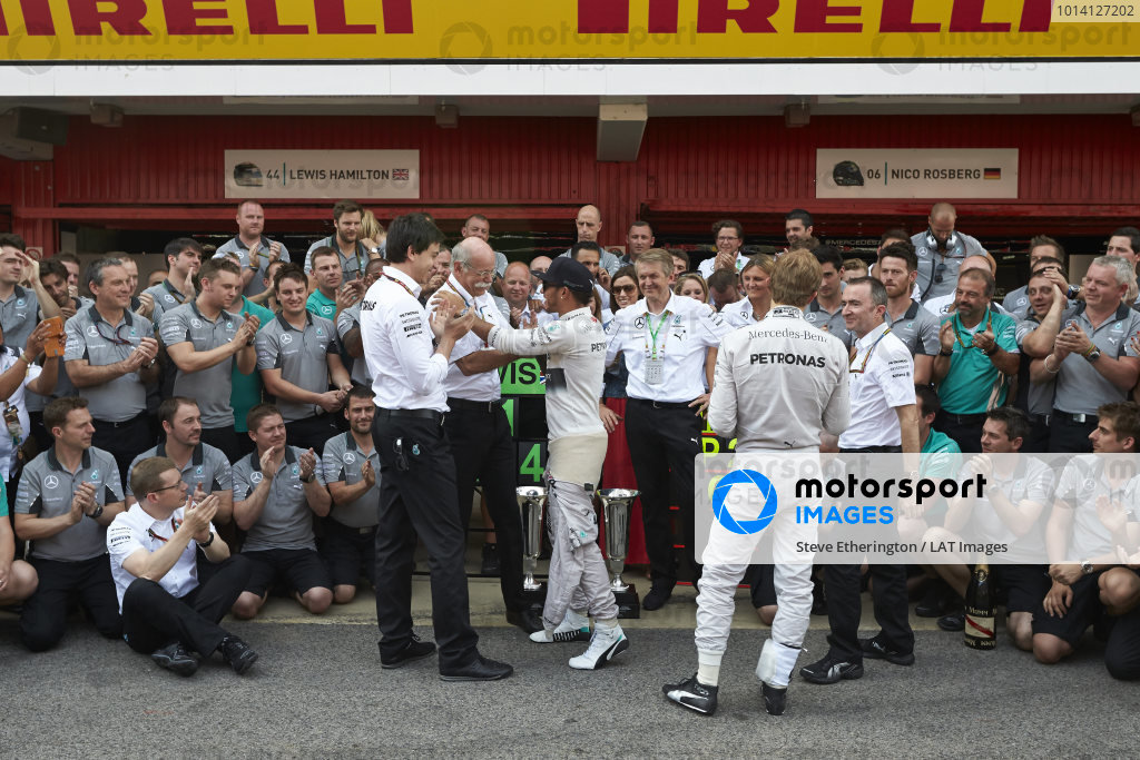 Circuit de Catalunya, Barcelona, Spain. Sunday 11 May 2014. Toto Wolff, Executive Director (Business), Mercedes AMG, Dr Dieter Zetsche, CEO, Mercedes Benz, Lewis Hamilton, Mercedes AMG, 1st Position, Nico Rosberg, Mercedes AMG, 2nd Position, and the Mercedes AMG team celebrate a perfect weekend. World Copyright: Steve EtheringtonLAT Photographic. ref: Digital Image SNE25393 copy