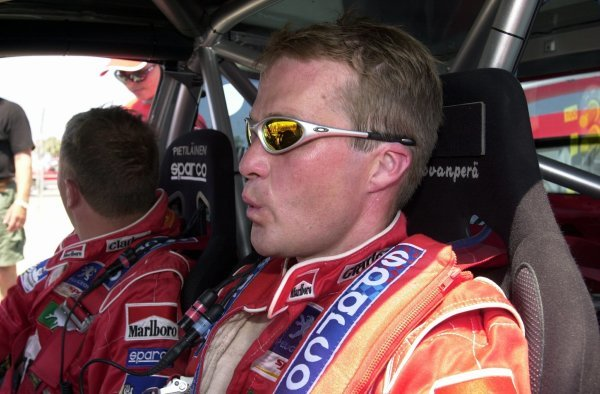 Second placed Harri Rovanpera (FIN) with co-driver Risto Pietilainen (FIN) Peugeot 206 WRC plays it cool in the heat of Cyprus.World Rally Championship, Rd7, Cyprus Rally, Limassol, Cyprus, Day Three, 22 June 2003.DIGITAL IMAGE