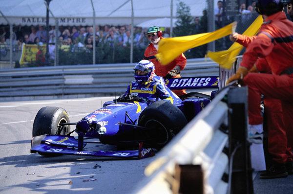Olivier Panis climbs out of his Ligier JS41 Mugen-Honda after a crash.
