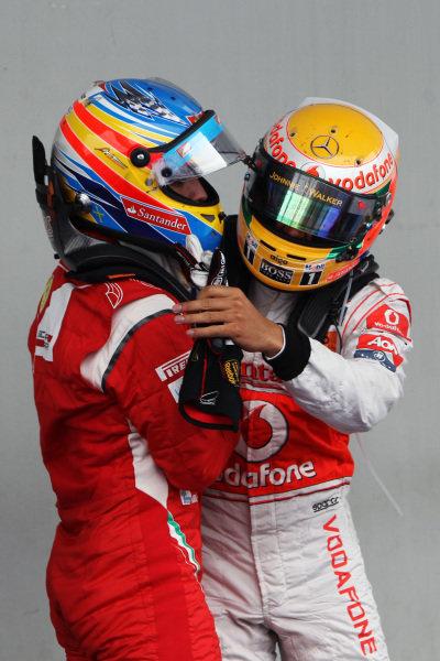 Race winner Lewis Hamilton (GBR) McLaren celebrates in parc ferme with second placed Fernando Alonso (ESP) Ferrari. Formula One World Championship, Rd 10, German Grand Prix, Race, Nurburgring, Germany, Sunday 24 July 2011.  BEST IMAGE