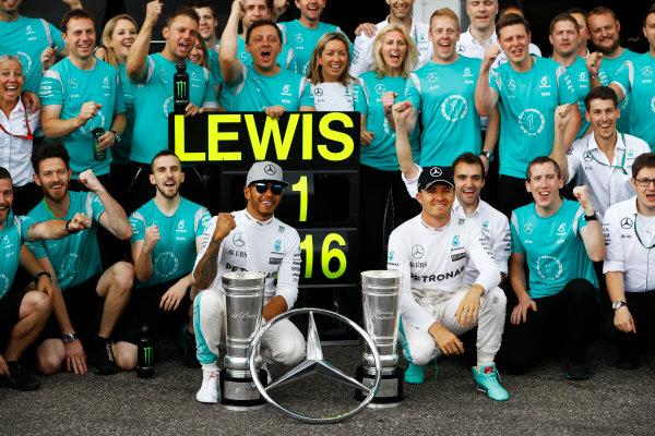 Hockenheim, Germany. Sunday 31 July 2016. Lewis Hamilton, Mercedes F1 W07 Hybrid, celebrates victory with Nico Rosberg, Mercedes AMG and colleagues. World Copyright: Andrew Hone/LAT Photographic ref: Digital Image _ONY1511