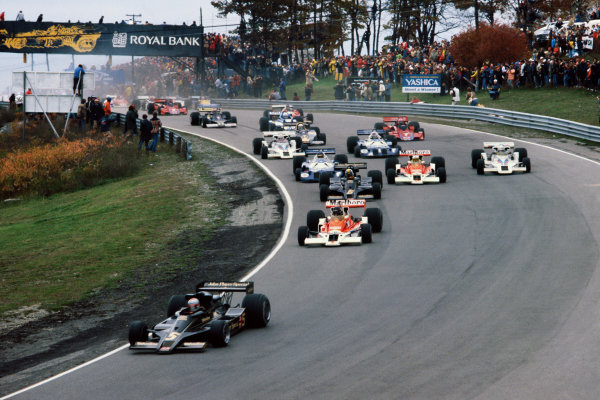 Mosport Park, Ontario, Canada.9th October  1977.Mario Andretti (Lotus 78 Ford) leads James Hunt (McLaren M26 Ford), Gunnar Nilsson (Lotus 78 Ford), Jochen Mass (McLaren M26 Ford) and Alan Jones (Shadow DN8 Ford) at the start, action. World Copyright: LAT Photographic.Ref:  77CAN09.