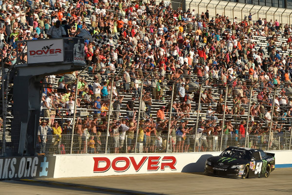 25-27 September, 2014, Dover, Delaware USA Kyle Busch, Monster Energy Toyota Camry crosses the finish line for the win under the checkered flag ?2014, Scott R LePage  LAT Photo USA