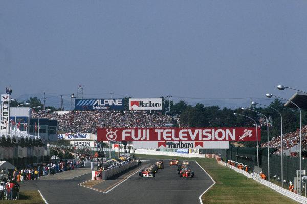 Suzuka, Japan.19-21 October 1990.Ayrton Senna (McLaren MP4/5B Honda) and Alain Prost (Ferrari 641) on the front row of the grid for the start. Ref-90 JAP 17.World Copyright - LAT Photographic.