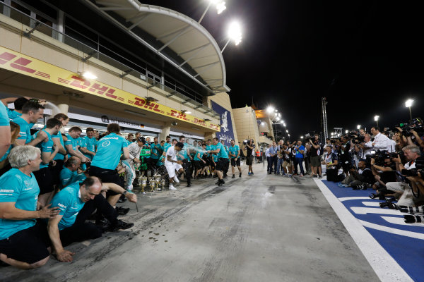 Bahrain International Circuit, Sakhir, Bahrain. Sunday 19 April 2015. Lewis Hamilton, Mercedes AMG, 1st Position, Nico Rosberg, Mercedes AMG, 3rd Position, and the Mercedes team celebrate victory. World Copyright: Alastair Staley/LAT Photographic. ref: Digital Image _79P9209