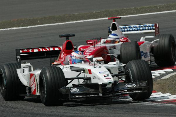 2003 European Grand Prix - Sunday Race, Nurburgring, Germany. 29th June 2003 Jenson Button, BAR Honda 005, leads Olivier Panis, Toyota TF103, action.World Copyright: Steve Etherington/LAT Photographic ref: Digital Image Only