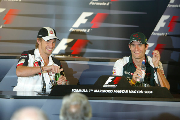 2004 Hungarian Grand Prix - Thursday,Hungaroring, Hungary.12th August 2004.Jenson Button, BAR Honda 006 and Mark Webber, Jaguar R5 , press conference.World Copyright LAT Photographic.Digital Image only (a high res version is available on request).