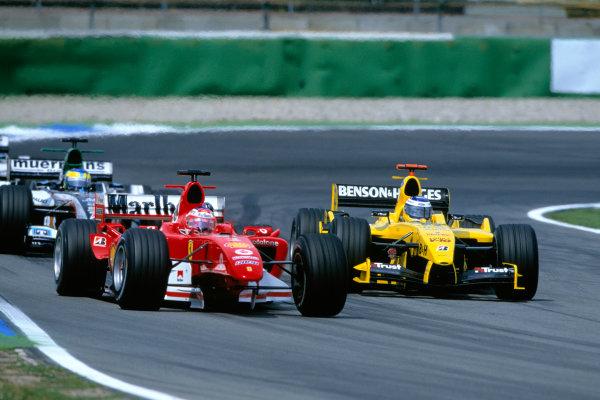 2004 German Grand PrixHockenheim, Germany. 23rd - 25th July.Rubens Barrichello, Ferrari F2004 makes his way back to the pits, as Nick Heidfeld, Jordan Ford EJ14 passes him. Action. World Copyright:Steven Tee/LAT Photographi--c Ref:35mm Image:A07