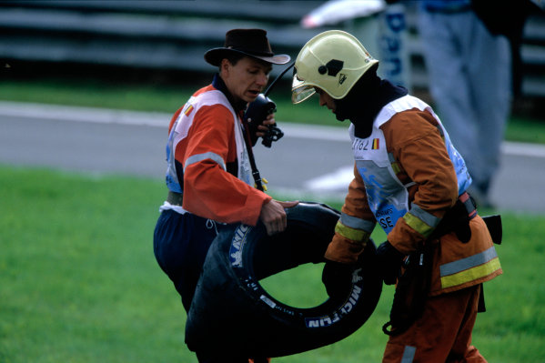 2004 Belgian Grand Prix.Spa Francorchamps, Belgium. 27th - 29th August.Two Marshalls carry a deflated Michelin tyre.World Copyright:LAT PhotographicRef:35mm Image A16