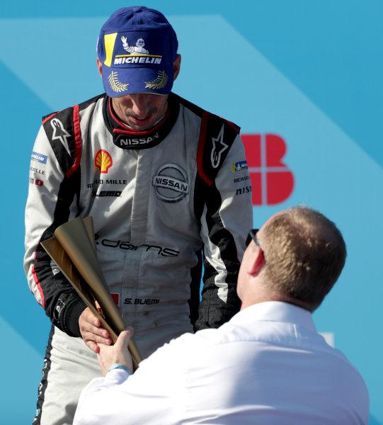 Sébastien Buemi (CHE), Nissan e.Dams, 2nd position, receives his trophy on the podium