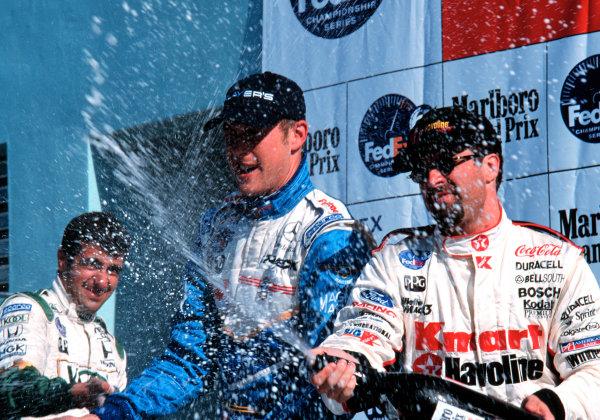 1999 CART MIAMI GP, 21-3-99, Homestead, FL, USADario Franchitti (3rd), Michael Andretti (2nd), and Greg Moore celebrate.-1999, Michael L. Levitt, LAT Photographic