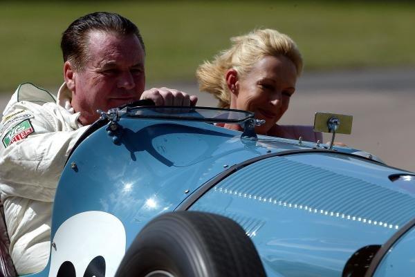 Alan Jones (AUS) gives a friend a ride up the Goodwood hill.Goodwood Festival of Speed, Goodwood, England, 25-27 June 2004.DIGITAL IMAGE