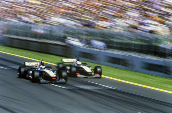 Mika Häkkinen, McLaren MP4-13 Mercedes, passes David Coulthard, McLaren MP4-13 Mercedes, who slows down after receiving a team order following a pre-race agreement.
