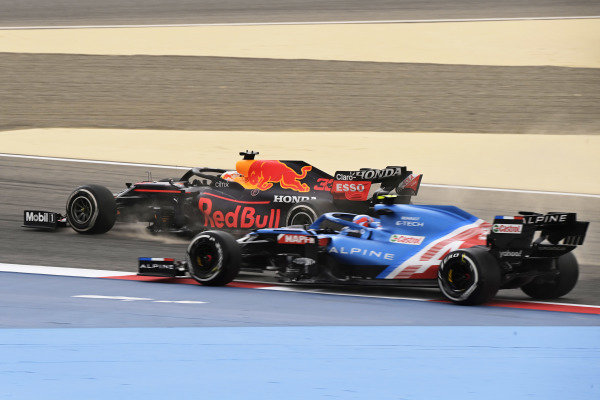 Max Verstappen, Red Bull Racing RB16B and Esteban Ocon, Alpine A521