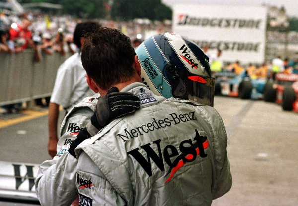 1998 Brazilian Grand Prix.Interlagos, Sao Paulo, Brazil.27-29 March 1998.Mika Hakkinen and David Coulthard (both McLaren Mercedes-Benz) after finishing in 1st and 2nd positions.World Copyright - Tee/LAT Photographic