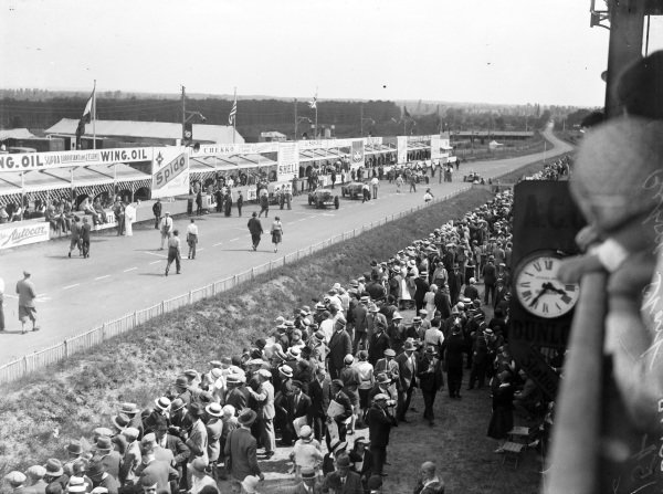 The main straight and pits, with fans gathered in large numbers opposite.